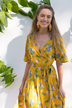 Cinnamon Island Style Golden Wrap Maxi Dress in golden yellow featuring botanical tropical island print with a flutter sleeve