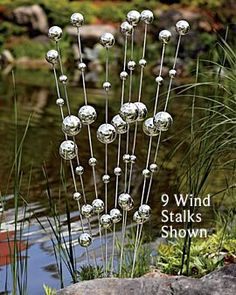 "Aren't these ""Wind Stalks"" so pretty?  But warning: You have to buy a number of these to have the effect in the photo...and at $44.95 for EACH stalk, that's quite a few pretty pennies you'll be parting with.  (Gardener's Supply Company is not offering the 3-pack anymore, so perhaps these will be discontinued.)  (2012)"