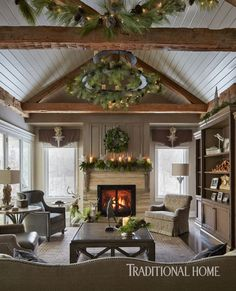 Christmas greenery descends into the family room, outfitted in handsome upholstered pieces. - Photo: Werner Straube / Design: Diane Young Ceiling, fireplace and beams Family Room Addition, Room Additions, Piece A Vivre, Family Room Design, Family Rooms, Traditional House, Christmas Home, Christmas Presents, Christmas Decor
