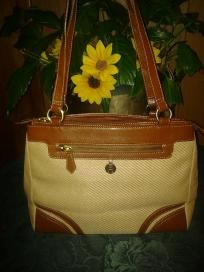 "Etienne. Aigner . Pretty purse 4. Woman. F 4 $32.99 size. L10"". W15"". Straps 12"" mint like new all"