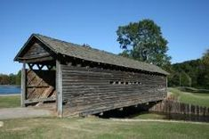 """Coldwater Covered Bridge - Built in 1850, the Coldwater Covered Bridge now stands at Oxford Lake Park in Oxford, Alabama.  It is the oldest """"kissing bridge"""" in Alabama."""