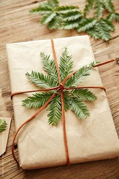#Gift wrapped in brown paper with #pine branches attached by Trinette Reed