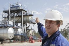 10113687-Oil-worker-in-industrial-oil-and-fuel-plant-Stock-Photo.jpg (1300×866)