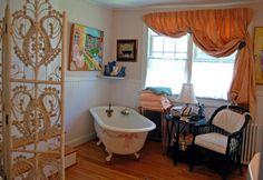 Wedding Cake House, Kennebunk, Maine - bathroom with old-fashioned clawfoot tub. Photo by Geraldine Aikman.