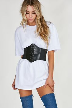 Trendy waist belt with faux leather panels with lace up design for adjustable fit. Bold elastic band with snap button closure in back.