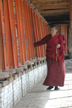 In the foothills of the Himalayas - a Tibetan monk turning prayer wheels - Tongren, Tibet - photo - staci j guthrie