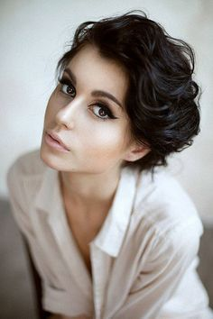 This is so elegant. Great short cut for thick curly haired or wavy hair girls, great liquid eyeliner!