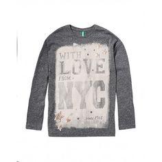 Camiseta, de punto efecto neps, manga larga, con estampado y aplicación de lentejuelas.