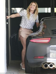 Glowing: The Lizzie McGuire star flashed a megawatt smile as she exited her vehicle and prepared to head into the gym