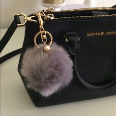 """LAST ONE! LIGHT GRAY POM POM KEYCHAIN!! Brand new never used!! Great condition no flaws. Faux fur Pom Pom keychain! Has gold chain and clamp with a small Pearl attached. Keychain hangs about 4"""".  So so cute to hang on your purse, handbag, or keys!! No trades. Accessories Key & Card Holders"""