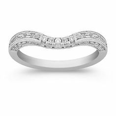 As part of our Rhapsody collection, this 14 karat white gold contour band was designed to complement the ring of your choice. Twenty-two round diamonds at approximately .20 carat TW, and ten baguette diamonds at approximately .22 carat TW, shimmer in an array of splendor.  With a total weight of .42 carat, these stones were hand-selected for superior fire and sparkle.