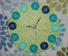 Ive always wanted a button clock for some reason. i think its cute! I got the clock part and base at Michaels.
