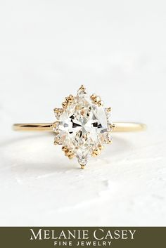 Our take on the classic halo engagement ring, this Unveiled Ring features an oval cut diamond surrounded by a unique frame of diamond accents atop a delicate 14k gold band. Available in yellow, rose, or white gold with a range of options for focal stone size, this piece can be found at melaniecasey.com! Oval Diamond, Gold Set, Diamond Engagement Rings, Halo Engagement, Gold Bands, Fine Jewelry, White Gold, Stone, Ring Boxes