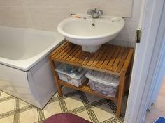 This is a brilliant way to cover up an ugly pedestal sink.