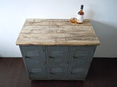 vintage metal lockers with reclaimed wood top on casters // industrial bar storage cabinet // kitchen island