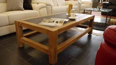 Beautiful coffee table in raw rustic solid teak with a slate top - direct from a famous designer furniture company in the UAE!