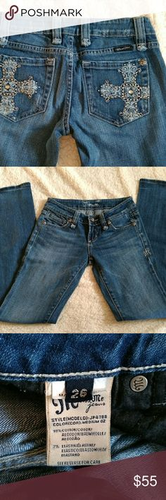 """Miss Me Jeans size 26 A beautiful pair of Miss Me jeans featuring crosses with studs and rhinestones.  Excellent condition with a little wear on the cuffs.  Measurements laid flat on table.  Inseam 31""""  Rise 7""""  Waist 13.5"""" across Miss Me Jeans Boot Cut"""