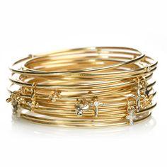 Erica Courtney stacking gold bracelets