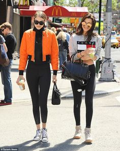 Stunning: The leggy pair turned heads as they grabbed a coffee in SoHo, in matching yoga pants on Sunday