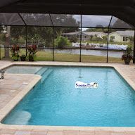 Superior Pools Large Swimming Pool with Large Paver Deck