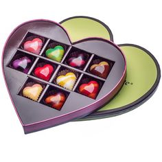 Shiny rainbow-streaked chocolate hearts from the Florida chocolatier Norman Love are not all show. They encase creamy bursts of bright flavors like cherry and vanilla, passion fruit and orange, milk chocolate and habanero, and dark rum with bittersweet chocolate. | 15 Chocolate Gifts for Valentine's Day (Photo: Tony Cenicola/The New York Times)