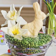 Kid's Easter Centerpiece | Nestle a white chocolate bunny in a glass bowl filled with dried peas for a playful arrangement during dinner and a tasty treat once the table is cleared. | SouthernLiving.com