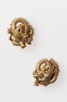 Pair of menuki in the form of dragons, one with a jewel and one with a sword  Japanese, Edo period–Meiji era, mid to late 19th century  By Sato Yoshiteru, Japanese, 1828–1902, gold, MFA