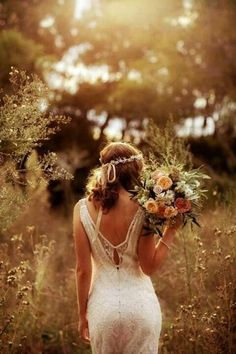 Love this detail shot! Back of dress, hair piece, bouquet... Gorgeous!