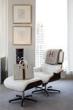 Pieces Inc - bedrooms - Eames Lounge and Ottoman, hermes throw, monogrammed throw blanket, white tufted lounge chair, gold bamboo frames, gold faux bamboo frames,