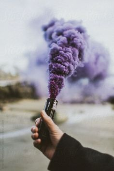 Purple smoke bomb by Brianna Wettlaufer. An exclusive image for Stocksy.com.