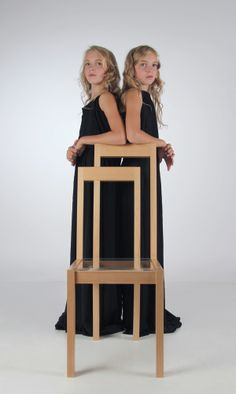 """Meander Chair"" made from beech  and plexiglass by Russian artist and designer Anna Goniaeva seemingly includes two chairs in one.  I took twins for the presentation because they are like symbols of my chair. I have two similar parts in it, but at the same time they are different at little. And they are cannot exist without each other."