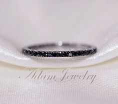 Hey, I found this really awesome Etsy listing at https://www.etsy.com/listing/178781830/025ct-black-diamond-wedding-band-14k