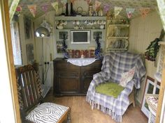 Little vintage hideaway at the bottom of an English cottage garden.