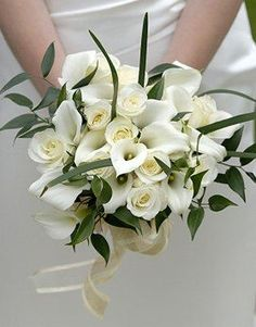 Calla Lilies  Calla lily bridal bouquets are popular for beach weddings because the soft curves of the flowers mimic the smooth sand and gentle waves. While white is one of the most popular shades, calla lilies are available in a wide range of colors to match any wedding palette.