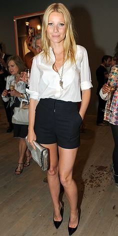 The shorts, the necklace, the heels, the clutch, and the classic white blouse all come together for this look!