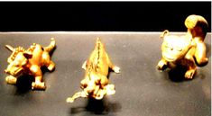 """Museo del Oro, Bogota, shows several creatures that the museum describes as reptiles. The creature with the man in his mouth is described variously as a reptile, a dragon and a crocodile."" ^**^"