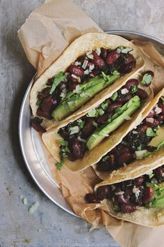 Classic Beans and Greens Tacos, naturally gluten-free + vegan. These bad boys take under 20 minutes to whip up. The perfect meal for busy, healthy, people.