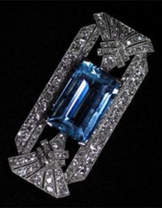 An Art Deco platinum brooch set with aquamarine and diamonds. Circa 1930.