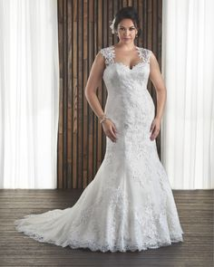 Bonny Bridal Gorgeous Bride Magazine wedding dress competition   Bonny Bridal Unforgettable 1712  This wedding gown is classy and elegant. Lace cap sleeves join to form a keyhole back. The corset closure allows the dress to fit your figure and gives a lovely silhouette.