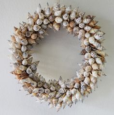 Medium Strombus Seashell Wreath from California Seashell Company (http://www.caseashells.com/medium-strombus-seashell-wreath/) #seashellwreath, #shellcrafts, #beachdecor, #californiaseashellcompany