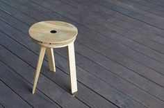 Tension Stool (Dmitry Kirgizov, 2014): a folding design with a curved seat and three legs.