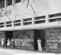 Batavia, Netherland East Indies. 1945-08-17. After the Japanese surrender and before Dutch troops could reach the East Indies, Indonesians proclaimed their independence. The ground floor of this building was painted with slogans stating Indonesian expectations including `Indonesian self-determination, liberty, equality, fraternity'.