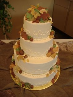 Fall Wedding Cake - 4 tier wedding cake with buttercream icing and gumpaste leaves in multiple colors.
