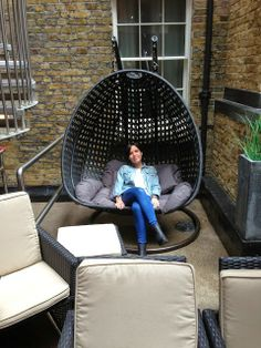 Chilling out in the stylish courtyard at Hotel Z in London, Soho - really want one of these hanging chairs for the garden, inspiration