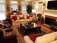 Family Room Makeover - new furniture arrangement with two sofas and two club chairs framing the rug