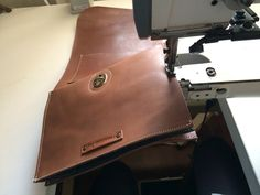 Stitching of the small leather satchel bag.