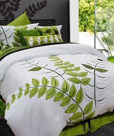 Glade's pure and clean appliqué ferns design coupled with its lily pond green and white colour combo evokes an undeniably polished serenity. Glade gives your bedroom a look of new simplicity with a touch of lush!     Consists of 100% cotton with 100% polyester appliqués, 220 thread count, embroidery and appliqué.