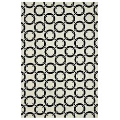 Rug with a linked circle motif in ivory and onyx.    Product: RugConstruction Material: 100% PolyesterCol...