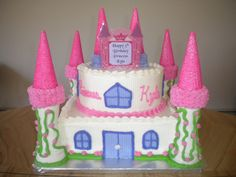 """Princess Castle Cake - 10"""" Vanilla square cake on bottom with 8"""" round on top frosted & decorated with butter cream. Turrets are ice cream cones bottom to bottom with sugar cone on top, all covered with royal icing and sugar sprinkles. Thanks for the many techniques and ideas on CC!"""