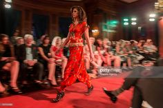 A model walks the red carpeted runway during a fashion show by Cemil Ipekci at the Turkish Ambassadors Residence in Washington, USA on April 19, 2016.